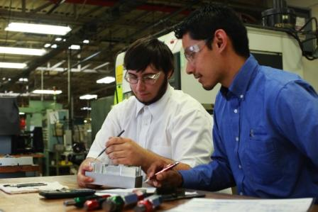 Manufacturing Engineer Manuel Vazquez (right) with Ferris student Nick Carrington (left)